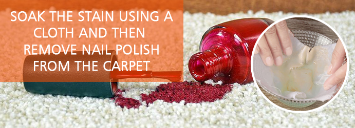 Soak the stain using a cloth & then remove nail polish from the carpet